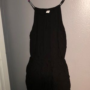 All black Romper, with pockets and cinched waist